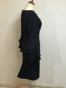 Black feather with layered cuffs-side